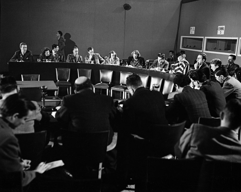 Mrs. Eleanor Roosevelt, Chairman of Human Rights Commission, and Dr. Charles Malik, Chairman of the General Assembly's Third Committee (second from right), during press conference after the completion of the Declaration of Human Rights.